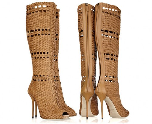 I'll say that Mr. with a scrunchie.  Gucci Woven Leather Boots ($3,750), although a bit more respectable...